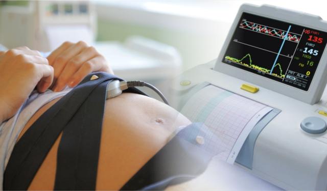 Причины болей у женщины во время беременности в области живота